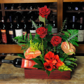 floral arrangement of flowers in a basket with wine - CELL 24003