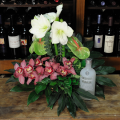 floral arrangement of flowers in a basket with vodka  - CELL 24007