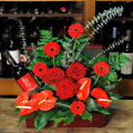 floral arrangement of flowers in a basket with wine - CELL 24010