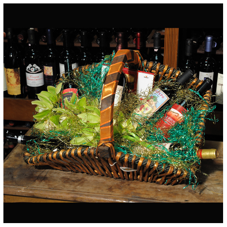 floral arrangement of flowers in a basket with wine and cokolate - CELL 24009