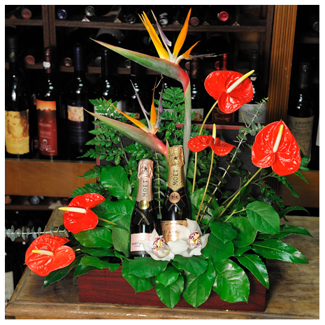 arrangement of mix flowers Bird of Paradise,Anthuria floral in a basket with drinks -  KAL 24001