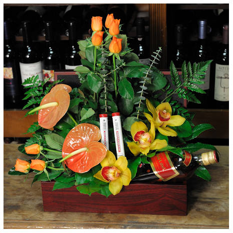 floral arrangement of flowers in a basket with drink