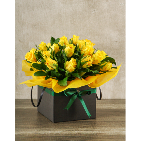 Yellow Roses in holder