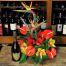 floral arrangement of flowers in a basket with champagne - CELL 24005